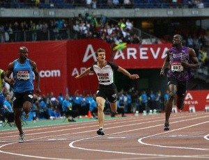 PARIS - JULY 16:  Usain Bolt (r) of Jamaica on his way to victory in the men's 100m from Christophe Lemaitre (c) of France and Asafa Powell (l) of Jamaica during the IAAF Diamond League meeting at the Stade de France on July 16, 2010 in Paris, France.  (Photo by Michael Steele/Getty Images)