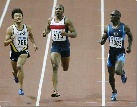 Japan's Shingo Suetsugu, left, Britain's Darren Campbell, centre and John Capel of the US, head for the line during their Men's 200 meters semi-final at the World Athletics Championships in the Stade de France, Saint Denis, north of Paris, Thursday Aug. 28, 2003.(AP Photo/Rusty Kennedy)