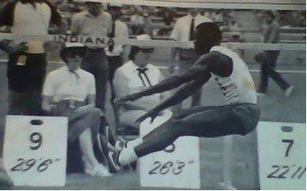 Carl Lewis extending legs in line with the direction of parabolic flight curve
