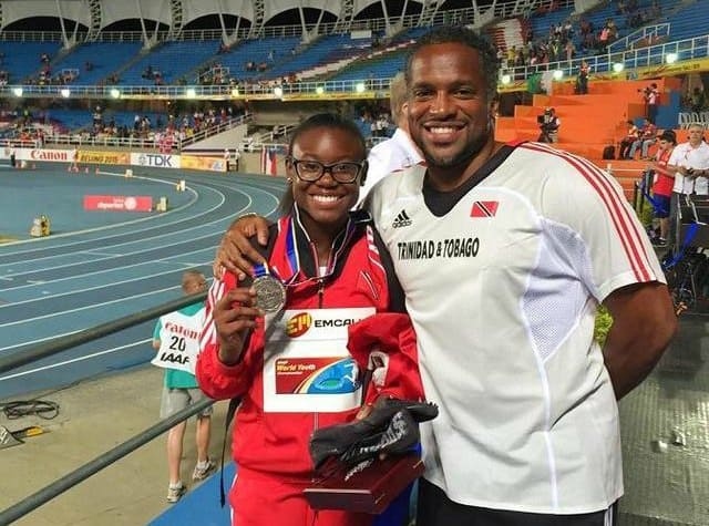 Khalifa St Fort showing off her 100m silver medal with coach Ato Boldon at Cali 2015