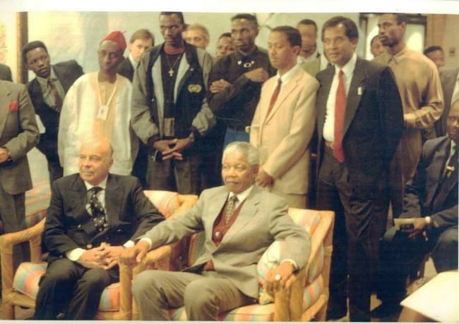 Ron Davis black suit behind Honorable Nelson Mandela and President of IAAF Primo Niebiolo